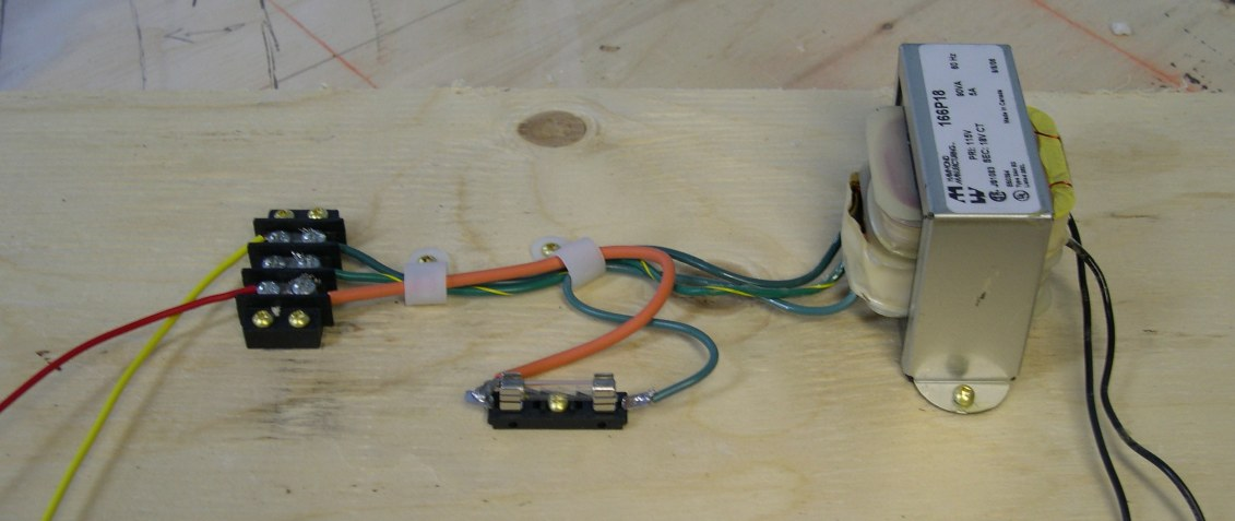 Power supplies energize the DCC layout. on
