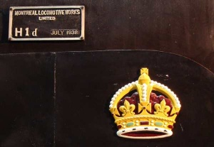 The gold royal crown above the cylinders, and builders plate