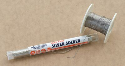 Solder on a roll, and in a dispenser.